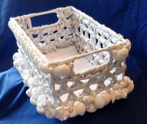 White wicker amenities basket with shells