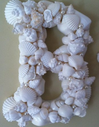 White Shells on Wooden Letter
