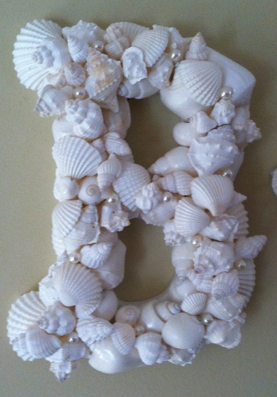 White Shells on Wooden Letter